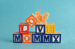 The words love mommy spelled with alphabet blocks Stock Photography