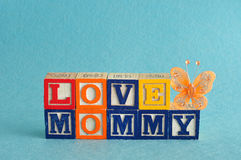 The words love mommy spelled with alphabet blocks Royalty Free Stock Photography