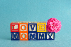 The words love mommy spelled with alphabet blocks Stock Photos