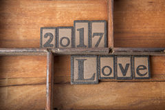 The words 2017 Love in wooden typeset. Stock Images
