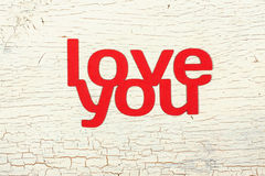 Words  love you  cut from paper. Words love you cut from paper on the old wooden door Royalty Free Stock Image