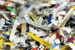 The words lubricate chassis with Shredded documents - Recycling concept Royalty Free Stock Photography