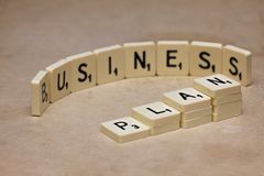 Words made from board game: business plan. Words made from board game, conceptual photography Royalty Free Stock Photos