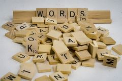 Words are made of letters. A bunch of scrambled game board pieces with, focusing on word Words Royalty Free Stock Image