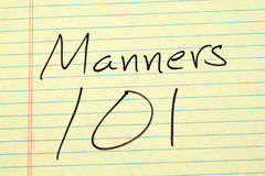 Manners 101 On A Yellow Legal Pad. The words `Manners 101` on a yellow legal pad Stock Photos