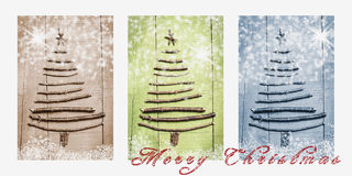 Words Merry Christmas written on snowy triptych in brown, green and blue. Christmas trees made of wooden branches Royalty Free Stock Image