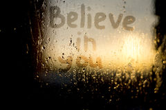 Words on the misted window. `Believe in you` words on the misted window Royalty Free Stock Photography