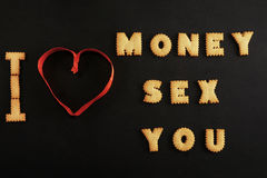 Words money, sex, you made with letters on black Stock Photos