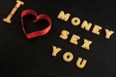 Words money, sex, you made with letters on black Stock Images