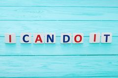 Words of motivation. I can do it. Blue wooden background, selective focus and copy space stock image