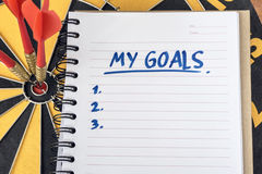 Words my goals on notebook with dart target background stock photos