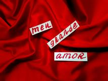 Words my great love written in portuguese on drapery red satin Royalty Free Stock Image