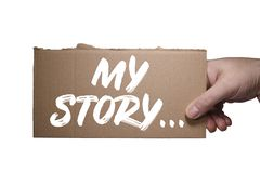 Words My Story written on cardboard. Clipping path. Hand holding torn piece of cardboard with words My Story. Currugated cardboard torn edge royalty free stock photos