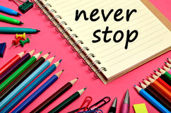 The words Never stop on notebook Royalty Free Stock Photo