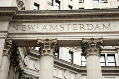 The words New Amsterdam, original name of New York, engraved in stone Royalty Free Stock Image