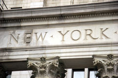 The words New York, engraved in stone in building, lower Manhattan Stock Photo