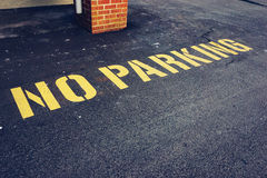 The words no parking painted on pavement Royalty Free Stock Photography