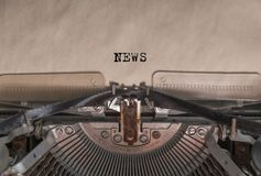 The words `Novosti`, written by an old typewriter. Letters on a piece of paper Stock Photo