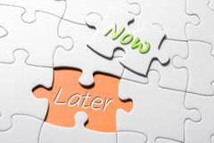 The Words Now And Later In Missing Piece Jigsaw Puzzle stock image