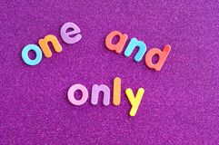 The words one and only in colorful letters. On a purple background Royalty Free Stock Images