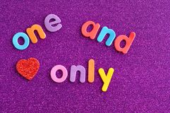 The words one and only in colorful letters. On a purple background with a red heart Royalty Free Stock Images
