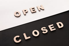 Words Open and Closed on contrast background Stock Photos