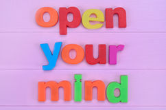 Words Open your mind on pink table Stock Photos