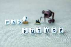 Words past blurred and future sharp on grey background with mini. Personal development and career growth or leting the past and be heading to the future concept stock photos