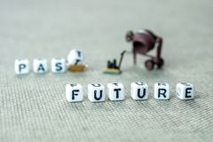 Words past blurred and future sharp on grey background with mini. Personal development and career growth or leting the past and be heading to the future concept stock images