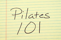 Pilates 101 On A Yellow Legal Pad. The words `Pilates 101` on a yellow legal pad Stock Images