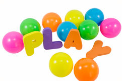 The words PLAY with colorful balls on white. The words PLAY with balls on white background Royalty Free Stock Photos