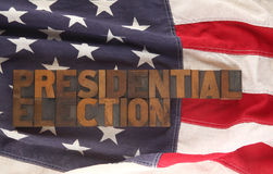 The words presidential election on a USA flag. Old letterpress wood type forms the words presidential election on an American flag Royalty Free Stock Image