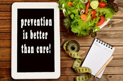 The words Prevention is better than cure on tablet pc stock photography