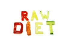"Words ""raw diet"" composed of slices of different vegetables. On white background royalty free stock photography"