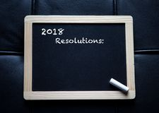2018 resolutions written on black board Stock Images