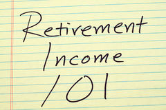 Retirement Income 101 On A Yellow Legal Pad Royalty Free Stock Images