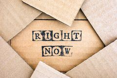 Words Right Now make by black alphabet stamps on cardboard. With some piece of cardboard Stock Image