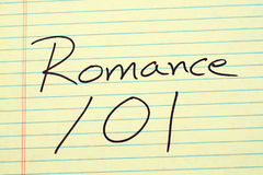 Romance 101 On A Yellow Legal Pad Stock Photography