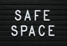 The words Safe Space in white plastic letters on a black letter board stock photos