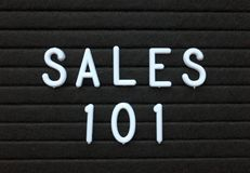 The phrase Sales 101 in white text on a letter board Royalty Free Stock Photo