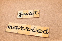 Words on sand just married Stock Images
