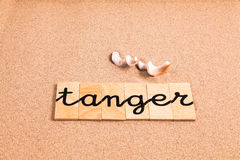 Words on sand tanger Stock Images