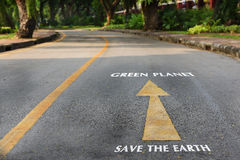 Words of save the earth and green planet on the road at the park. Earth day concept Stock Photo