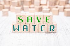 The Words Save Water Formed By Wooden Blocks On A White Table. The Words Save Water Formed By Wooden Blocks On White Table stock image