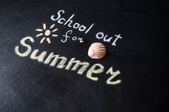 The words School's Out written on a chalkboard Stock Photography