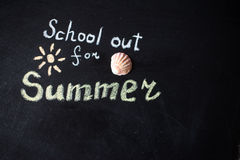 The words School's Out written on a chalkboard Stock Photo