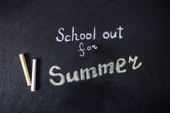 The words School's Out written on a chalkboard Royalty Free Stock Photos