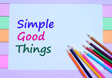 The words Simple Good Things on paper. The words Simple Good Things on white paper stock photo