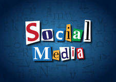 The words Social Media made from cutout letters. On a blue background Royalty Free Stock Image