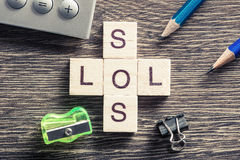 Words SOS And LOL On Table Made Of Wooden Cubes Elements Stock Images